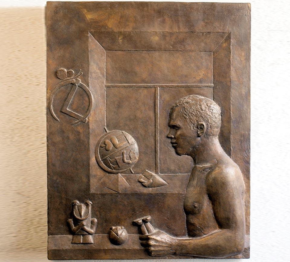 Bildhauer mit Globus